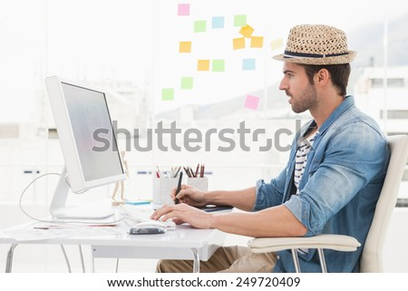 Casual designer using computer and digitizer in the ofice - stock photo