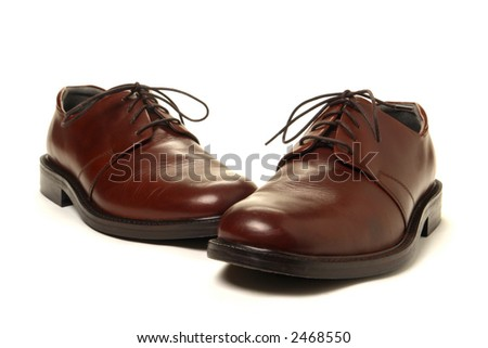 Casual dress men leather shoes over white background - stock photo
