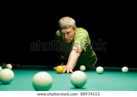 Casual dressed man plays russian billiards - stock photo