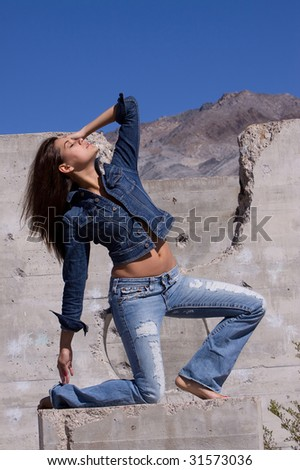 Casual dressed woman in blue jeans - stock photo