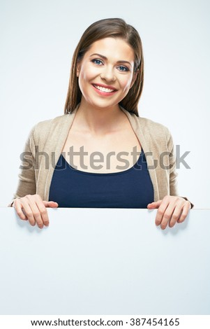 Casual dressed young woman standing with blank sign board. White background isolated. - stock photo
