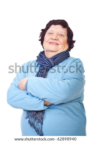 Casual elderly woman standing with arms folded isolated on white background - stock photo
