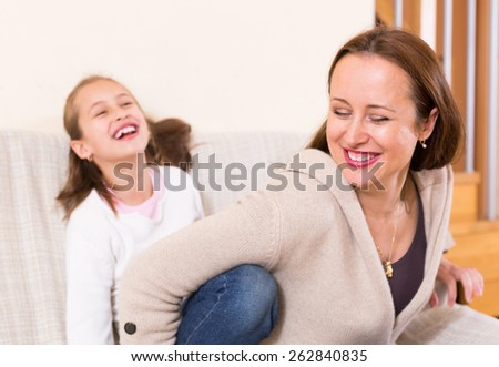 Casual family portrait of happy cheerful mother with child. Focus on woman - stock photo