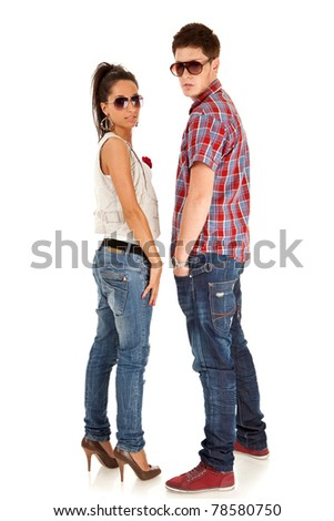 casual fashion couple wearing sunglasses on a white background - stock photo