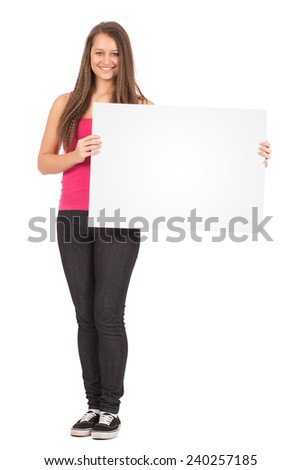 Casual Female In Pink Shirt Holding a Blank Billboard Isolated on White Background - stock photo
