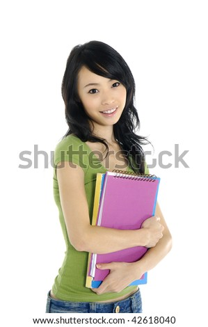casual female student smiling and holding a notebook - stock photo