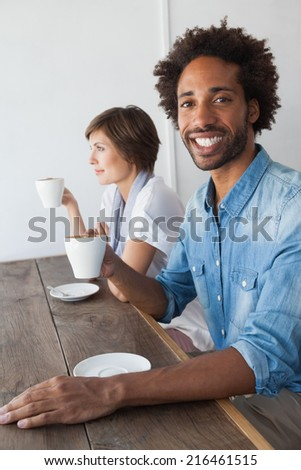 Casual friends having coffee together at the coffee shop - stock photo