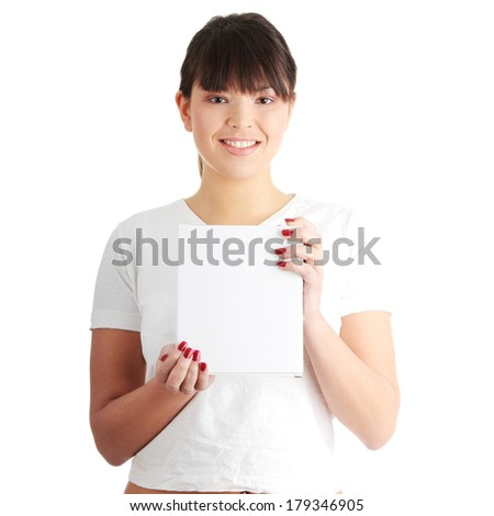 Casual girl holding blank white box (empty paper sign with a lot of copy space), isolated on white background - stock photo