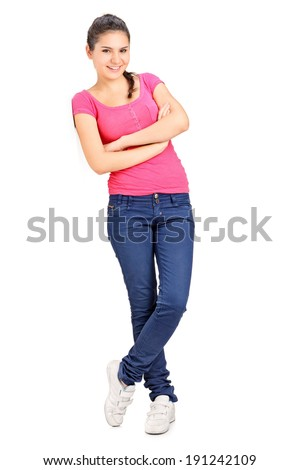 Casual girl leaning against a wall isolated on white background - stock photo