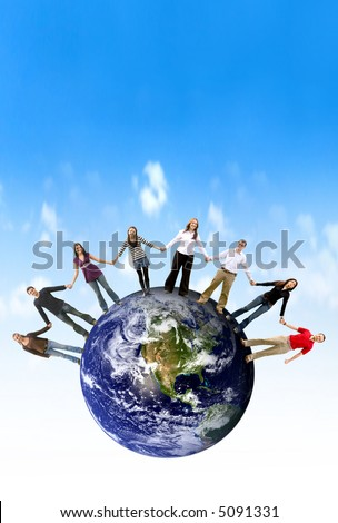 Casual group of friends holding hands around the globe - stock photo