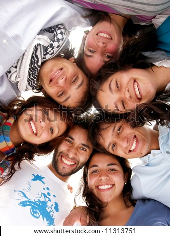 casual group of happy young people smiling isolated over a white background - stock photo