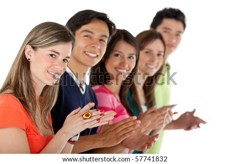 Casual group of people in a row applauding - isolated over a white background - stock photo