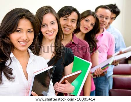 casual group of students lead by a female student - stock photo