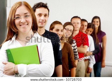 casual group of students lead by a teacher - stock photo