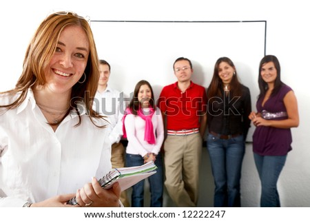 casual group of students lead by a teacher in a classroom - stock photo