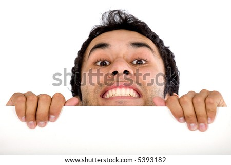 casual guy appearing over a white board isolated - stock photo