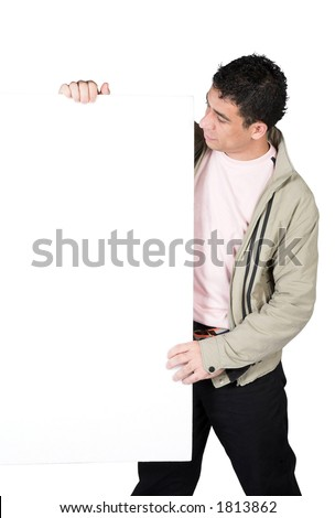 casual guy holding a white board over a white background - clipping path included - stock photo