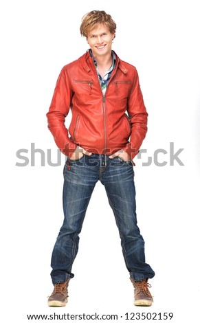 Casual guy smiling with hands in pocket. Full length portrait isolated on white background - stock photo