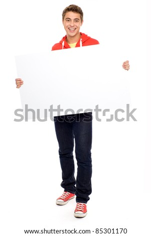 Casual guy with blank placard - stock photo