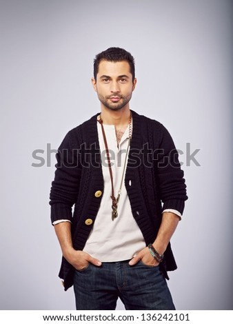 Casual guy with hands in his pocket - stock photo