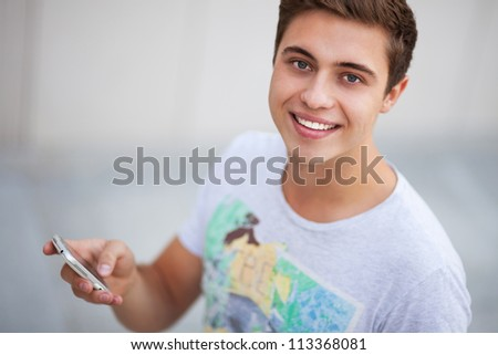 Casual guy with mobile phone - stock photo