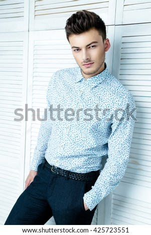Casual handsome attractive portrait  of mature businessman wearing blue shirt - stock photo