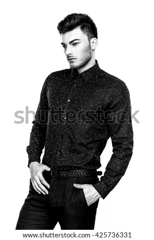 Casual handsome attractive portrait  of mature businessman wearing dark blue shirt on white background black and white photo - stock photo