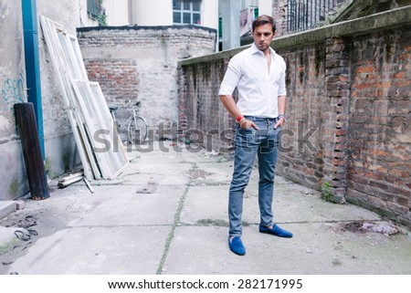 Casual handsome young man outdoors - stock photo
