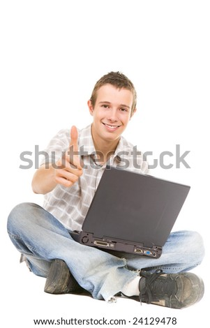 casual happy teenager with laptop.over white background - stock photo
