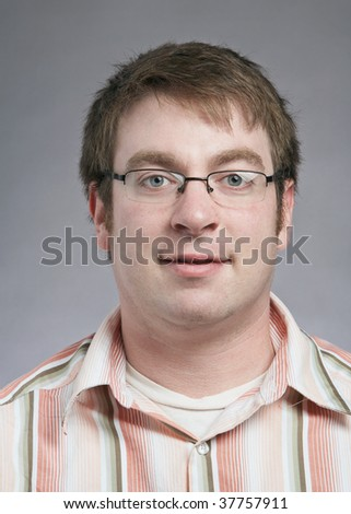 Casual happy young man isolated on grey background - stock photo