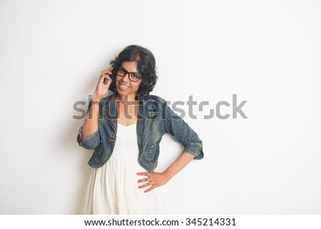 casual indian female on phone conversation - stock photo