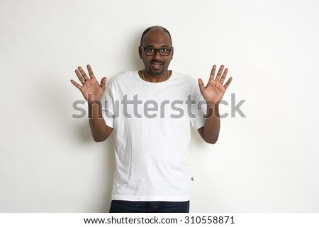 casual indian male shock - stock photo