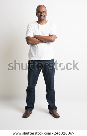 casual indian male smiling full length with jeans - stock photo