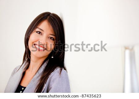 Casual indoors woman smiling at her apartment