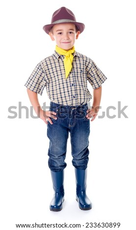 Casual little cowboy standing in blue jeans and boots - stock photo