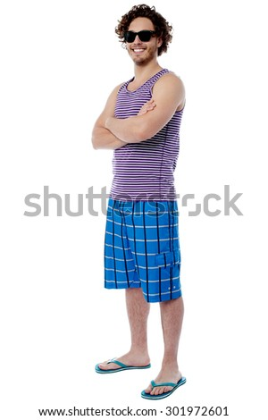 Casual male in beach wear and sunglasses  - stock photo
