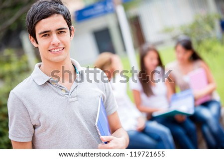 Casual male student at college looking happy