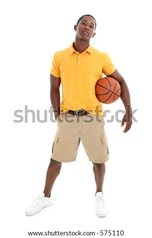 Casual man dressed in yellow pullover shirt and khaki shorts holding basketball.  Shot in studio over white. - stock photo