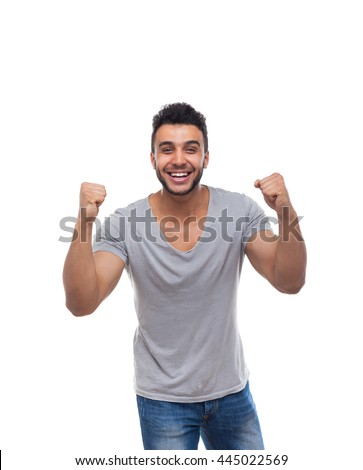 Casual Man Excited Hold Hands Fist Up Happy Smile Young Handsome Guy Wear Shirt Jeans Isolated White Background - stock photo