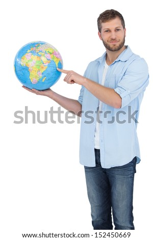 Casual man holding a globe on white background