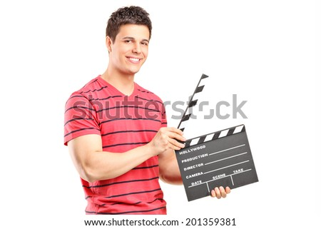 Casual man holding an open movie clap isolated on white background - stock photo