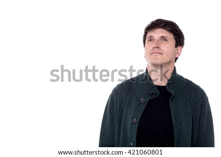 Casual man in knitted wear looking away.