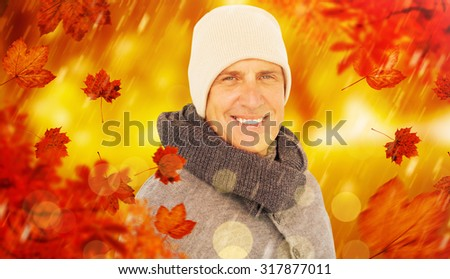 Casual man in warm clothing against park