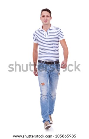 Casual Man is walking towards the camera on White background - stock photo