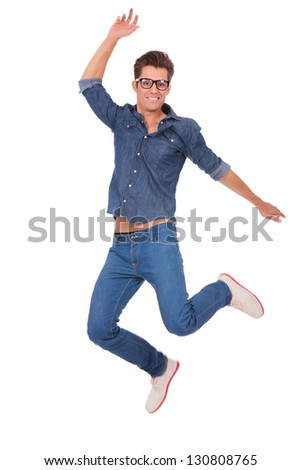casual man jumping and smiling to the camera, over white background - stock photo