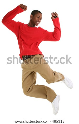 Casual man jumping. Holding car keys. Wearing khakis and long sleeve red shirt. Shot in studio over white. - stock photo