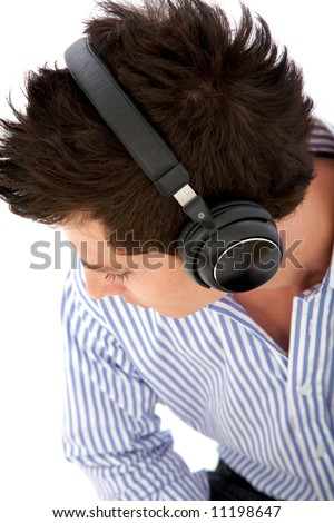 casual man listening to music in his headphones isolated over a white background - stock photo