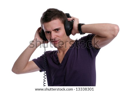 Casual man listening to music, isolated in white background - stock photo