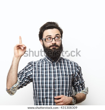 Casual man looking up and pointing his finger to blank space over white background. I have an Idea concept - stock photo