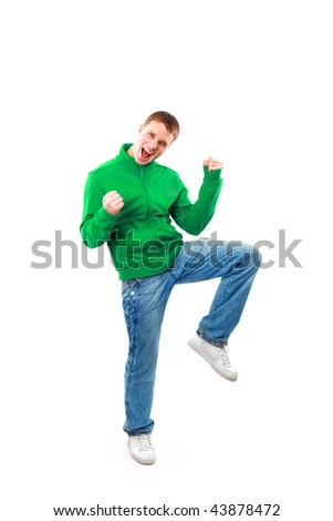 casual man looking very happy with his arms up - stock photo